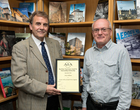 Retired English Heritage senior manager Keith Falconer presenting Mike Williams (English Heritage) with an award for the 'Textile Mills of South West England' book.