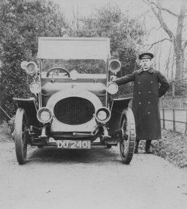 Riley car with chauffeur c1910